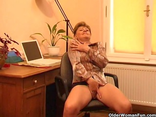 Granny in heat masturbates behind her desk