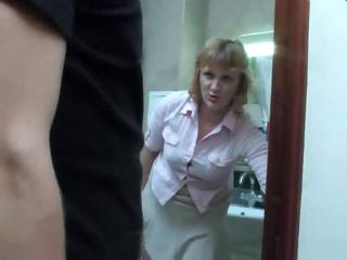 Mature mom takes a piss on the toilet and gets