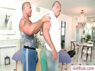 Muscled mature man gets massaged
