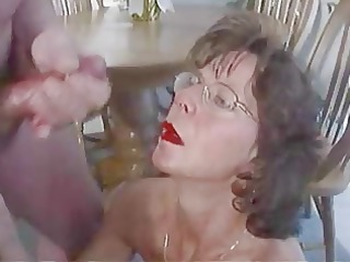 Mature brunette in glasses cherishes huge facial