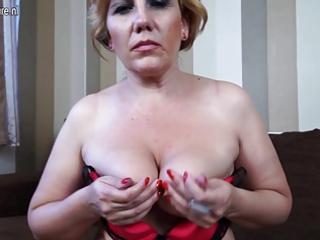 Blonde mature slut mom masturbating on the couch