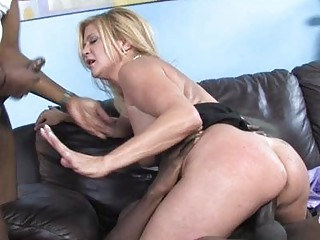 Slutty MILF babe shags with black dude in front