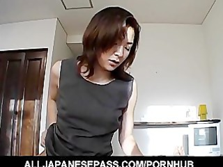 Japanese MiLF in an office suit sucks a big cock