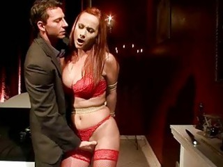 Busty redheaded MILF gets bondaged and fucked