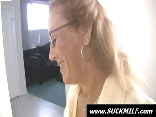 Mom wearing glasses gives this young dude a