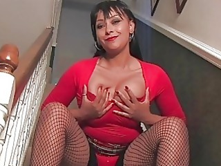 Nasty dark haired milf with huge hooters in