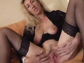 Nasty mature blonde spreads her pussy lips and