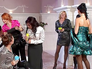 Gorgeous milfs in sexy dresses having group sex