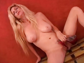 Busty MILF loves high heels