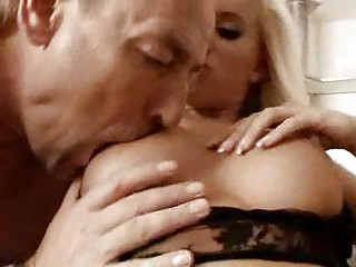 Milf blonde in black lingerie gets jugs sucked