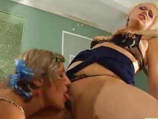 Lesbian MILF kissing a girl