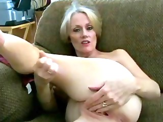 Mature blonde amateur Melanie slur[s on hubbys