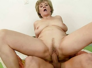 Busty grandma enjoys sex with young man
