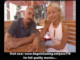 Stunning blonde mom talking with a man