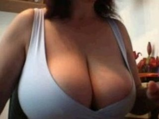 Wife plays her huge tits