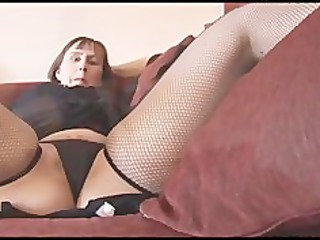 Busty mature brunette with hairy pussy strips and
