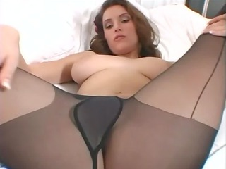 Busty brunette MILF teases in black pantyhose
