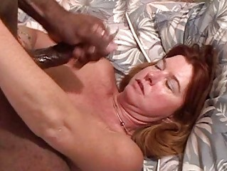 White redhead milf with big hooters sucks dark