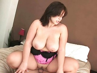 Big breasted MILF hoe rides her lovers massive