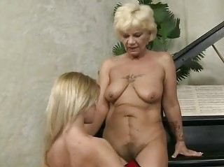 Granny and cute teen having fun