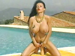 Mature babe with huge pierced tits and multiple