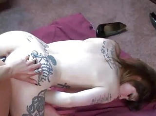 Tattooed Indigo shares a dong with a horny MILF