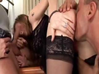 Sexy brunette MILF gives a double blowjob and