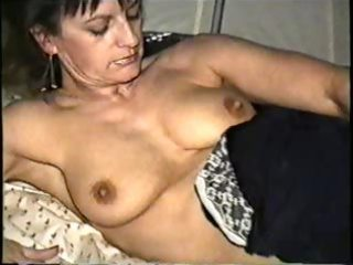 Naked milf poses and sucks cock