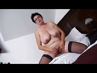 Chubby mature brunette strips and masturbates on