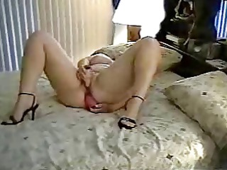 Mature wife uses two toys on bed. Amateur older