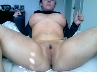 Busty wife strips and masturbates