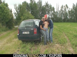 Granny is double fucked outdoors