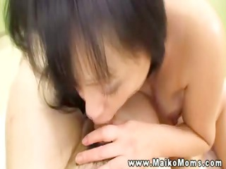 Oriental mature drools and jerks dick before