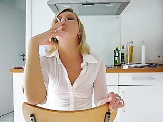 Janis smoking sexy in kitchen