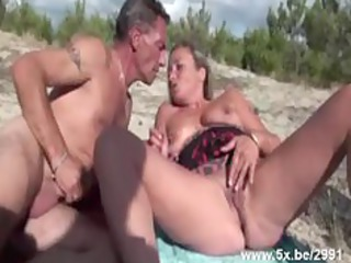 French mature gangbanged on the beach