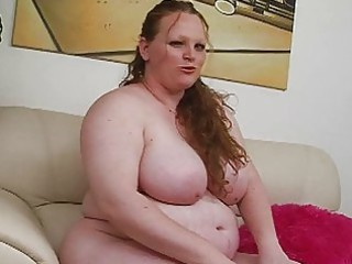 Pale huge redhead momma uses her new sex toy on