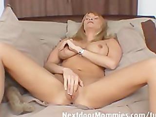 Older woman with huge tits masturbates
