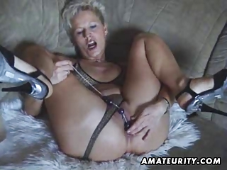 Busty amateur Milf toys and sucks with facial